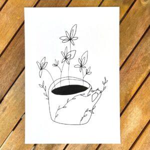 obrázek hrnku kávy s květinami
